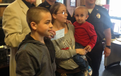 Cops for Kids' Donates $5,000 to Toddler with Cancer