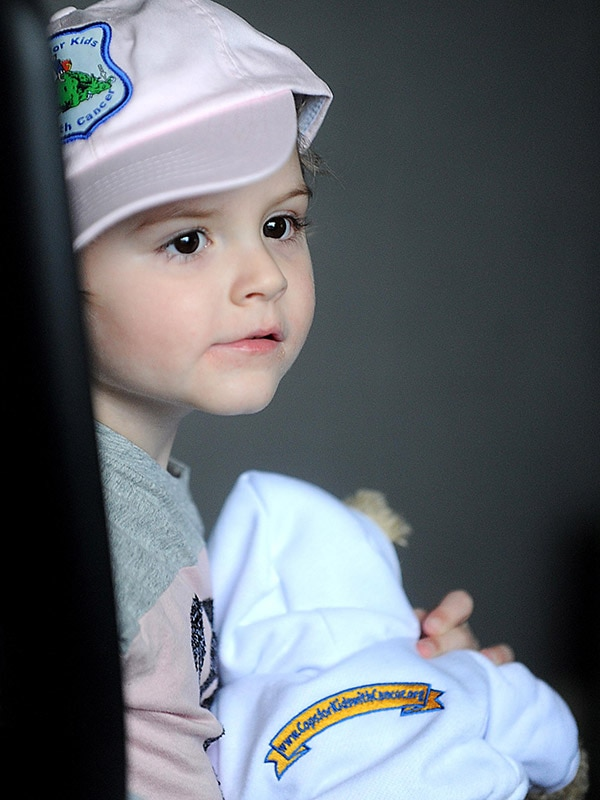 Adrianna sits in the chair of state police Col. Richard McKeon at state police headquarters