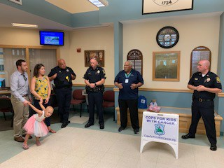 CFKWC Makes Donation at the Litchfield (NH) Police Dept., to 10 yr old Maddy Rifkin