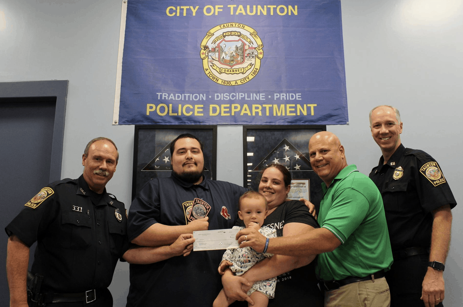 Cops for Kids with Cancer gives donation to couple whose 1-year-old daughter was born with a rare form of a childhood cancer.