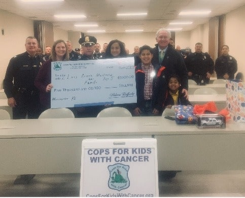 CFKWC and Worcester Police Department donate to 5-year-old Luiz Jimenez and his family.