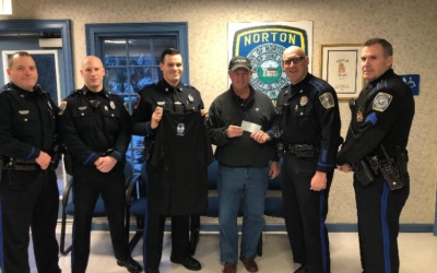 Norton Police Department present a check to CFKWC for No Shave November 2019