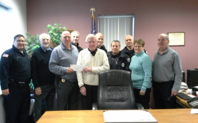 CFKWC goes to Clinton PD to accept $11,600 donation from department from golf tournament