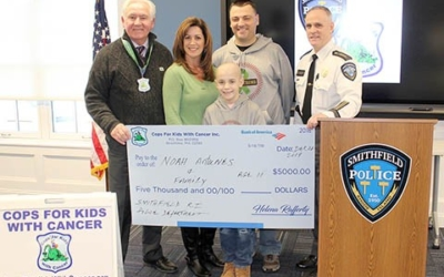 CFKWC and Smithfield Police Station give $5,000 to Antunes family.