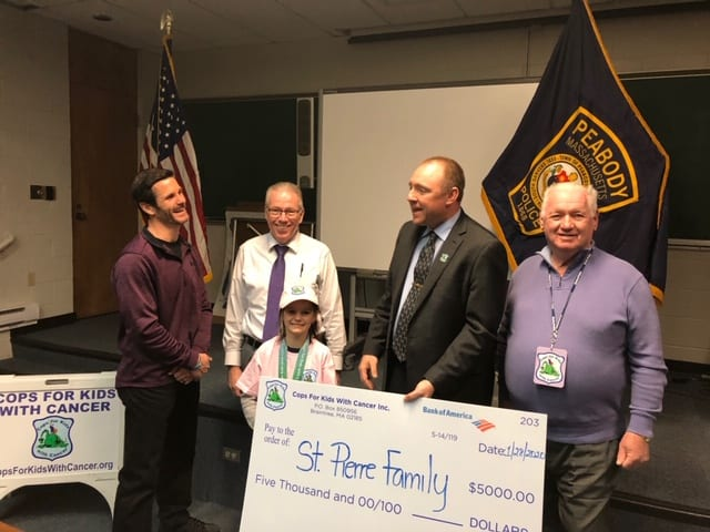 Sgt. Jim Harkins of Peabody Police Department and Eddie McNelley, both of CFKWC , went to Peabody Police Department and Made a donation to Madeline St. Pierre , 10 yr