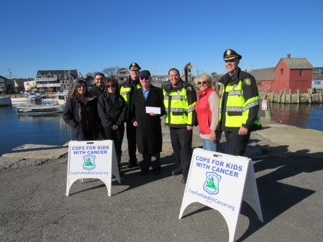 CFKWC goes to Rockport Police Department to accept a $6,600 Donation