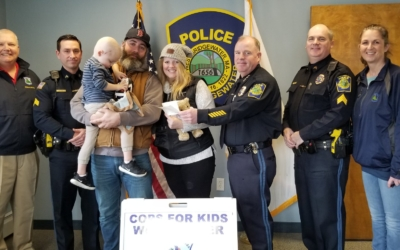 CFKWC and West Bridgewater PD make donation toJase Russell age 3 yrs., and his parents