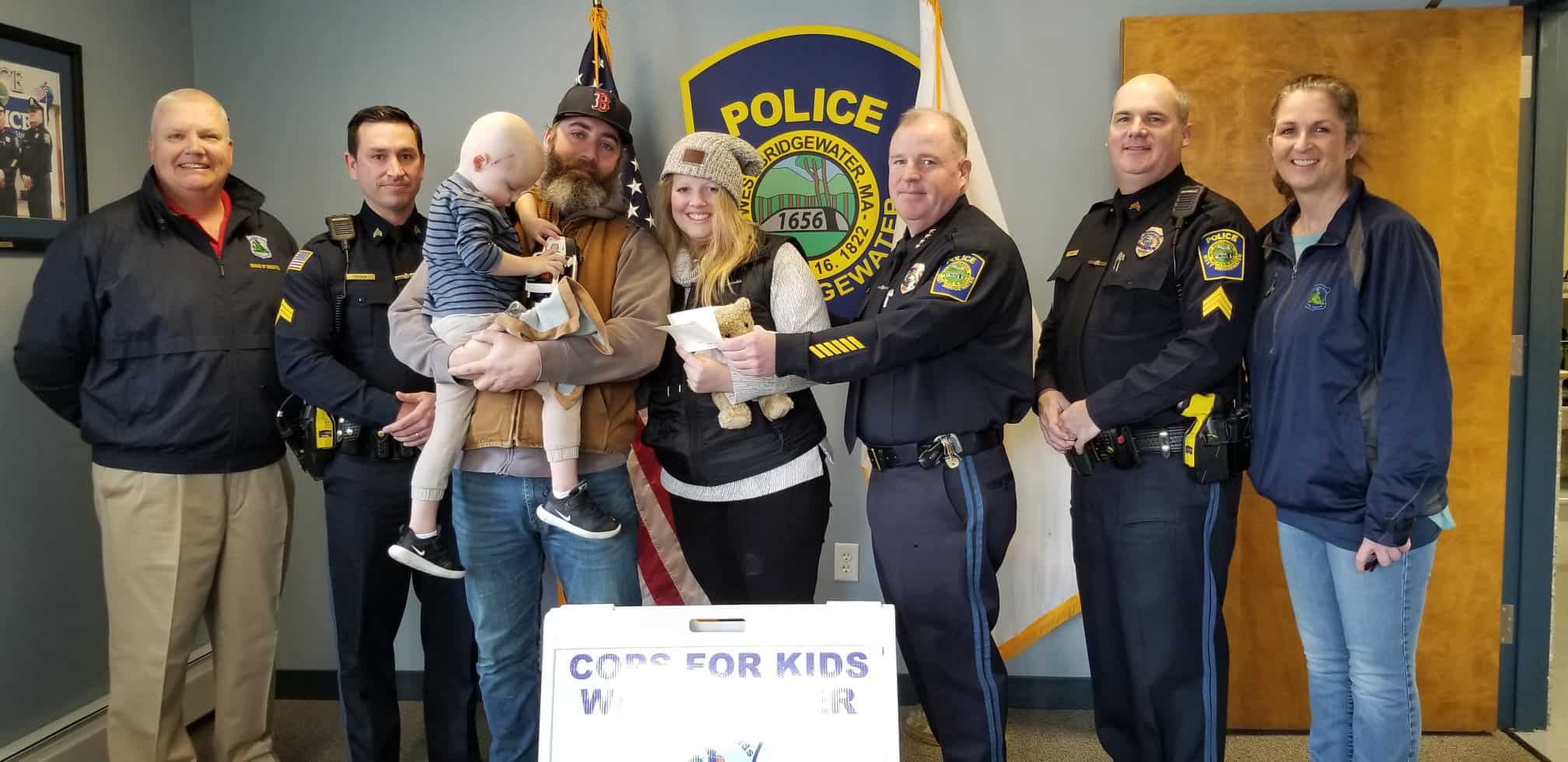 CFKWC and West Bridgewater PD make donation to Jase Russell age 3 yrs., and his parents