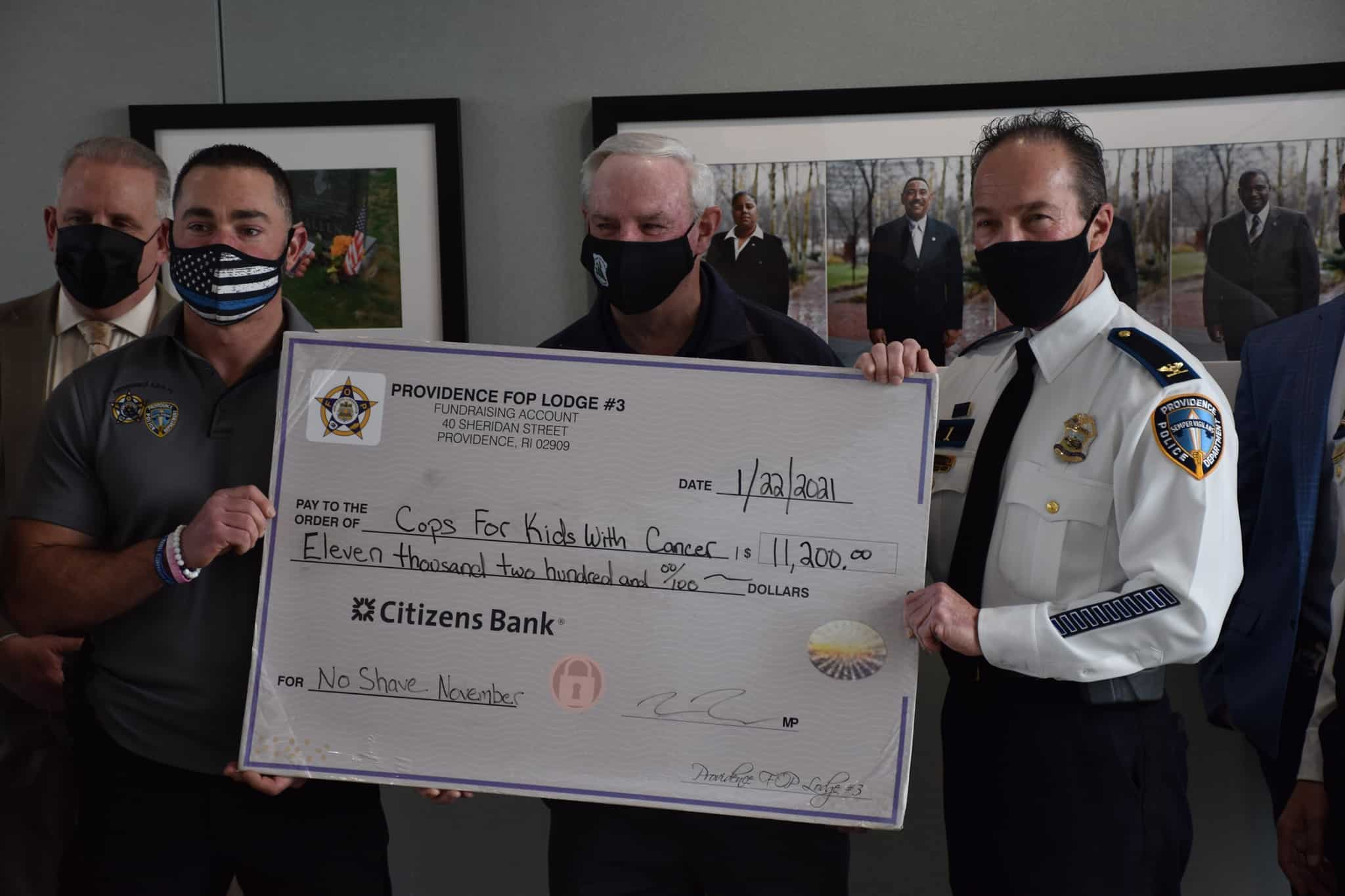 Check donation of$11,200 for CFKWC No Shave November Campaign