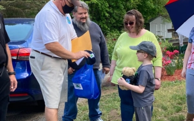 Tom Reed of CFKWC made a donation to 7 year old Luke Silva and parents, Kathy & Jason of Kingston.